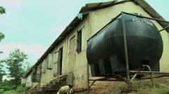 GHANA WIDE ON PAKRO SCHOOL WITH POLYTANK AND SHEEP IN FG Stock Footage