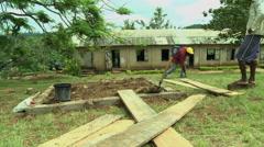 GHANA WIDE ON WORKER BUILDING PLATFORM OF PAKRO SCHOOL Stock Footage