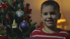 Little Boy With New Year gift - stock footage
