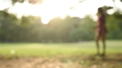 Girl walk alone in the park against sun light - stock footage