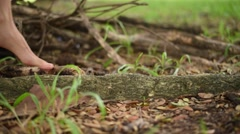 Girl walk alone on root of the tree - stock footage