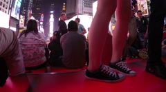 Detail of crowded bleacher seats and Times Square in NYC at night - stock footage
