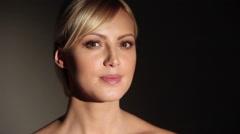 Beautiful caucasian blonde woman smiling at camera - stock footage