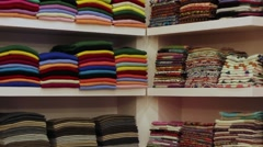 Shelves with pashminas Stock Footage