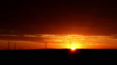 Red Sunrise over Powerlines Stock Footage