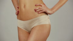 Fit woman showing her perfect body against a white background Stock Footage