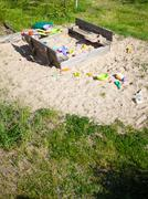Childhood. Sandpit sandbox with toys on playground. - stock photo