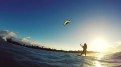 Stock Video Footage of Extreme Kitesurfing Girl at Sunset. Summer Ocean Sport in Slow Motion.