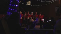 A choir sings Christmas carols at night Stock Footage