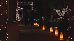 Christmas shoppers at a festival of lights Stock Footage