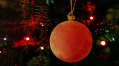 Red New Year's ball on background of  blinking garland fires Stock Footage