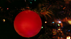 Red New Year's ball on background of  blinking garland fires - stock footage