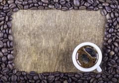 Background of coffee on old wooden surface top view Stock Photos