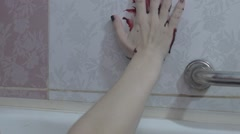 The bloody trail on the wall of the bath by hand Stock Footage