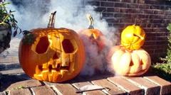Creepy pumpkin in fog halloween Stock Footage