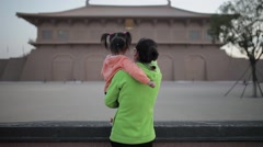 View of Mother and daughter talking outdoors ,Xi'an, Shaanxi, China Stock Footage