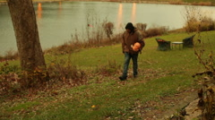 Man walking with pumpkin in arms Stock Footage