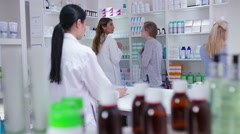 4K Staff working & serving customers in a chemist shop - stock footage