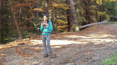 Stock Video Footage of Woman talking on loudspeaker in the autumnal forest