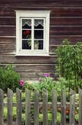 Window of an old traditional log house Stock Photos