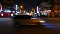 Dark road crossing, low rise buildings, T-junction, motorbike traffic Stock Footage
