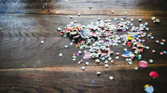 Stop motion and animation of confetti on the table Stock Footage