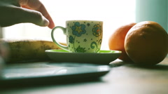 Hands chatting with smartphone and drinking coffee, indoor for a break time, Stock Footage
