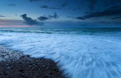 Atlantic ocean waves in dusk Stock Photos