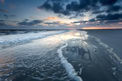 Sunrise on North sea beach Stock Photos
