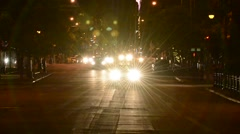 Oncoming traffic at night Stock Footage