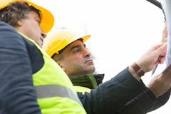 Constructor worker and engineer at construction site Stock Photos