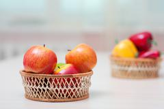 Baskets with ripe red apples Stock Photos