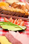 Abundance food cheese, sausage, bread, green onions,tomatoes, cucumbers,mashe Stock Photos