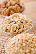 Peeled hazelnuts (walnut, cashew, pine) Stock Photos