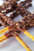 Wheat crossed sticks with chocolate Stock Photos