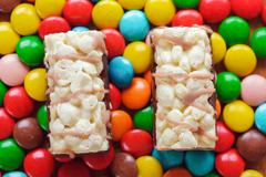 Multi-colored candies and two cakes Stock Photos