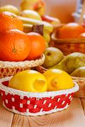 Lemons, oranges, pears and apples - stock photo