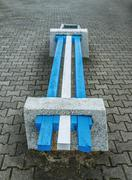 Wooden bench with stone foundation Stock Photos
