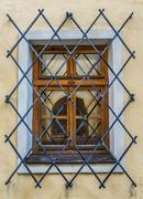 Window with wrought iron bars Stock Photos