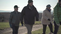 group of seniors on walk in countryside - stock footage