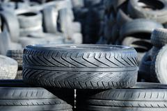 Old Tires on a waste deposit - stock photo