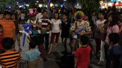 Stock Video Footage of balloon sellers in night Saigon city downtown