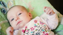 Cute newborn baby laying in the bed Stock Footage
