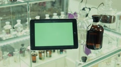 The tablet with the green screen on a show-window in shop of perfume Stock Footage