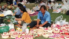 People produce krathongs during Loi Krathong festival in Sukhoithai, Thailand. - stock footage