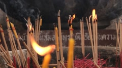Candles burn in Sri Chum temple in Sukhothai, Thailand. Stock Footage