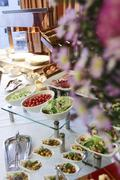 Assorted fresh salads displayed on a buffet, individual containers at catered - stock photo