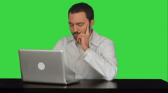Young doctor thinking idea with laptop computer on the table on a Green Screen Stock Footage