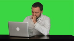 Stock Video Footage of Doctor working on a laptop looking tired on a Green Screen, Chroma Key