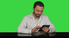 Smiling doctor using tablet on a Green Screen, Chroma Key - stock footage